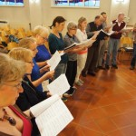 The choir studying a new song